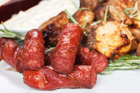 Grilled sausage with sauce and vegetables photo