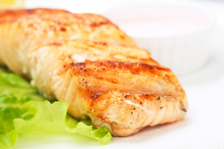 grilled salmon on white plate