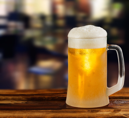 cold light beer glass mug in a pub Stock Photo