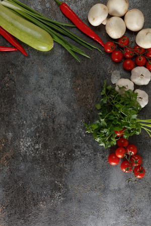 Fresh juicy vegetables with copy space on black background, top view. Stock Photo