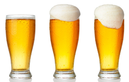 Set of a glass of cold light beer with foam isolated on white background Stock Photo