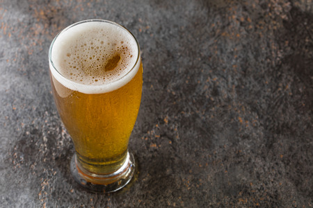 mug with beer on a vintage background Stock Photo