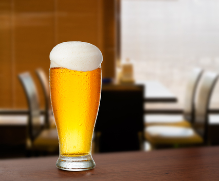 cold glass with beer on the background of bar. Stock Photo - 97985509