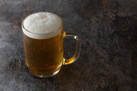 mug with beer on a vintage background Stock Photo - 98120235