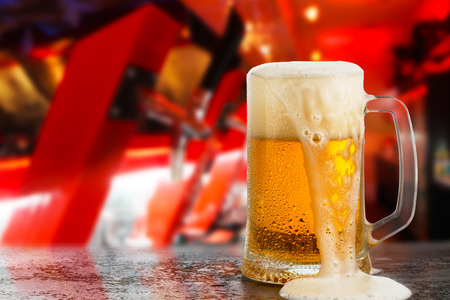 cold light beer glass mug in a pub Foto de archivo