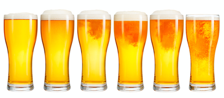 Set of a glass of cold light beer with foam isolated on white background Фото со стока