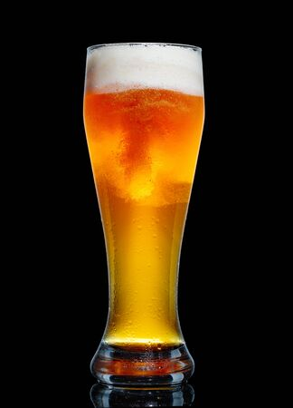 Glass of beer isolated on black background.