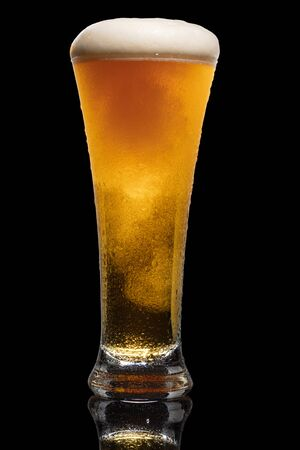 Glass of beer isolated on black background. Standard-Bild