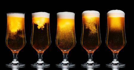 Set of Glasses of Beer Isolated on Black Background Standard-Bild