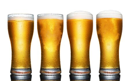 Set of a glass of cold light beer with foam isolated on white background Standard-Bild