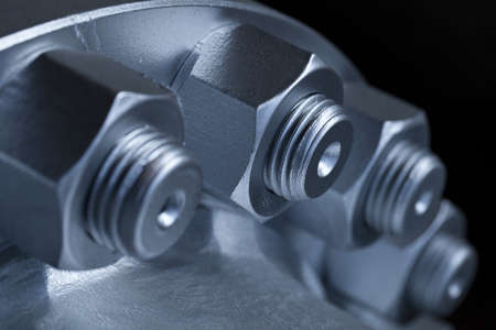 bolts and nuts:  joint of two flanges by bolts and nuts Stock Photo