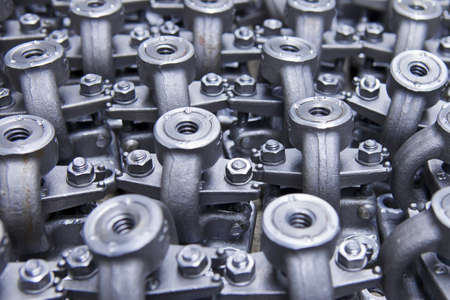 euro screw: Industrial background from part of assembled valves Stock Photo