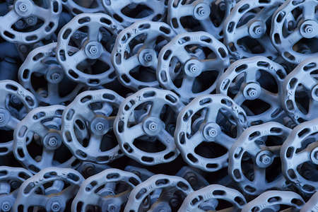 euro screw: Background from hand wheel of industrial valves ready for dispatch on Euro pallet