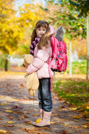 ways to go: Prague, Czech Republic - September 1, 2010  First-grader girl with a school bag and toys goes to  school Editorial