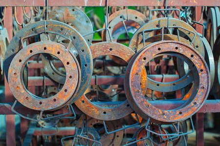 Rusted steel flanges are stored in a warehouse,  Industrial area of old factory Stok Fotoğraf - 31035619