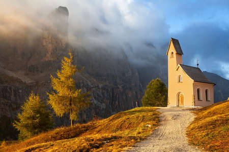 church tower: Small chapel with mountains in the background, Passo Gardena, Dolomiti Mountains, Alta Badia, Italy