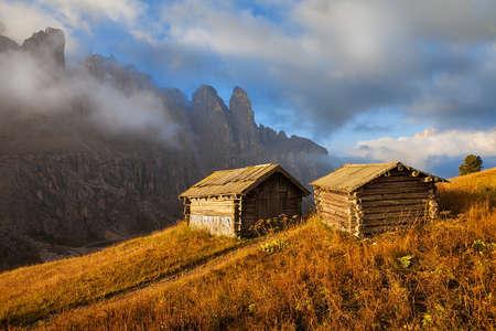 Abode of sheeps shepherd with mountains in the background, Passo Gardena, Dolomiti Mountains, Alta Badia, Italy photo