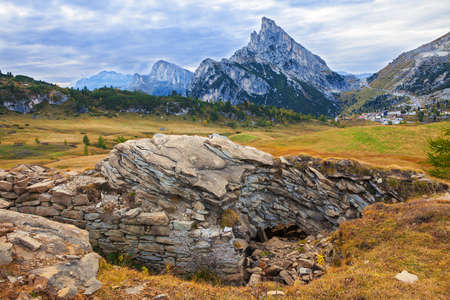 stria: Mount Sass de Stria and  stone trench from first world war on foreground,  Falzarego path, Dolomites - Italy