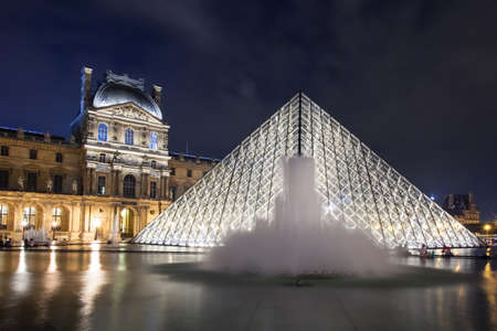 louvre pyramid: France, Paris - Nov 25: The Louvre Pyramid on November 25, 2013 in Paris, France. It serves as the main entrance to the Louvre Museum. Completed in 1989 it has become a landmark of Paris.