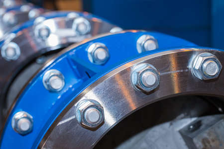 flanges: The flanges of valves with bolts and nuts Stock Photo