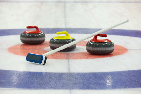 Stone for game in curling on ice 写真素材