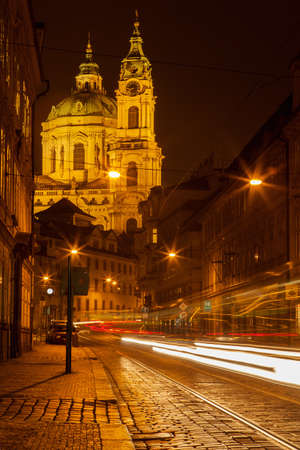 saint nicolas: Prague street with Saint Nicolas church, Czech republic