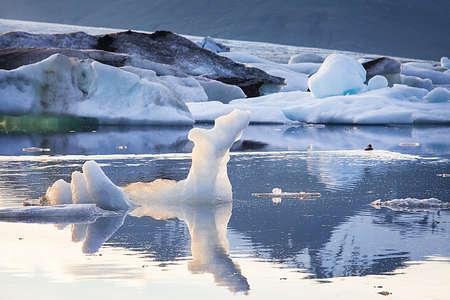 Floating icebergs in Jokulsarlon Glacier Lagoon, Iceland photo