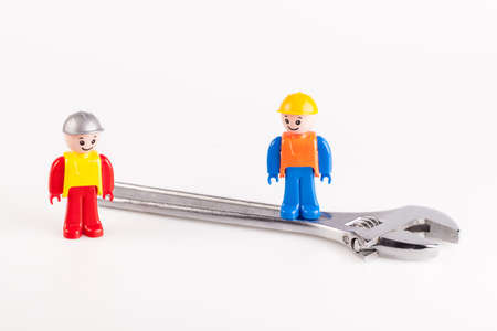 miniatures: Miniatures of construction workers isolated on white background