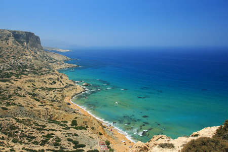 nudism: Coast of Crete island in Greece. Red Beach of famous Matala. Stock Photo