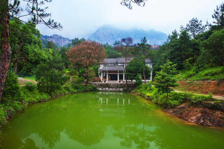 Chinese lake with temple and mountain scenery. Wenzhou Yandang mountain in China Stok Fotoğraf