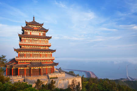 china art: Beautiful ancient temple on the seaside with blue sky and fog, Dongtou island, Wenzhou, Zhejiang province, China