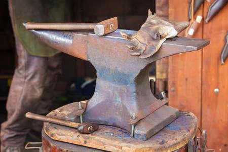 forger: Detail shot of hammer on blacksmith anvil Stock Photo