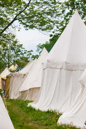 encampment: The medieval knights camp with white tents