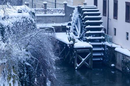 water mill: Czech Republic - Prague -  Water mill nearest Charles Bridge in winter morning during snowfall