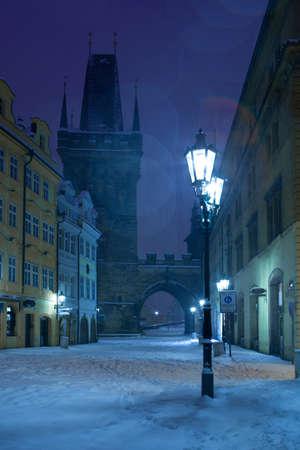 czech culture: Czech Republic - Prague -  Charles Bridge in winter morning during snawfall Stock Photo