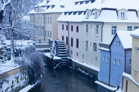 charles bridge: Czech Republic - Prague -  Water mill nearest Charles Bridge in winter morning during snowfall