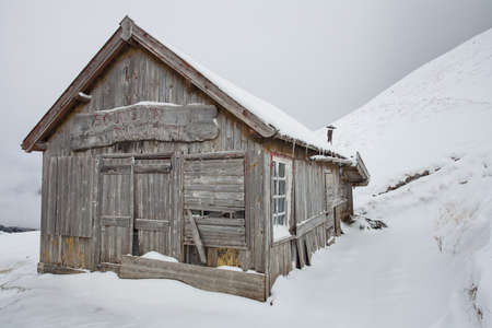 wonderful winter scenery with snow and timber cabin chalet home