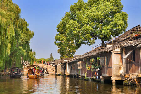 Wuzhen, China - June 24, 2016: Wuzhen a famous scenic historic water town in China. Wuzhen is part of Tongxiang, located in northern Zhejiang Province, China. Editöryel