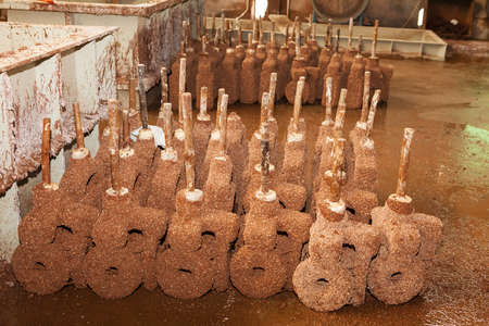 Lost-wax casting, wax pattern covered by sand ceramic, during process of drying. Casting foundry for producing of castings for valve, machine, automotive, train and parts for heavy industry