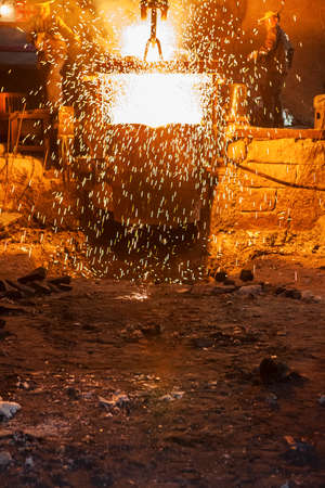 Molten metal. Left over material from the steel manufacturing process is poured away on at a Steel Foundry Stok Fotoğraf
