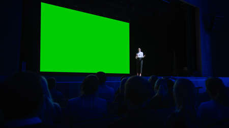 Keynote Speaker Announces New Product to the Audience, Behind Her Movie Theater with Green Screen, Mock-up, Chroma Key. Female CEO Shows Leadership on Business Live Event or Device Reveal