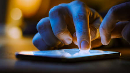 Touch Screen Smartphone Lying on the Table while Person is Typing a Message. Concept of Email Writing, Chatting in Social Media Apps, Sending an SMS, Taking Note. Close-up Macro View