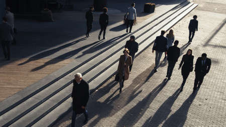 Office Managers and Business People Commute to Work in the Morning or from Office on a Sunny Day on Foot. Pedestrians are Dressed Smartly. Successful People Walking in Downtown. Shot from Above. Фото со стока