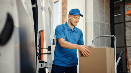Delivery Man Uses Hand Truck Trolley Full of Cardboard Boxes and Packages, Loads Parcels into Truck Van. Professional Courier Loader helping you Move, Delivering Your Purchased Items Efficiently