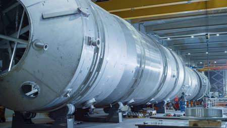 Heavy Industry Manufacturing Facility Factory where Large Diameter Pipe is Being Assembled. Modern Industrial Manufacturing Technology to Design and Construct Oil, Gas and Fuels Transport Pipeline.