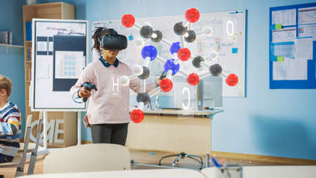 Cute Girl Wearing Augmented Reality Headset and Using Controllers Interacts with 3D Molecule. Futuristic School Science Class for Children Learning in STEM Programs. VFX, Special Effects Render