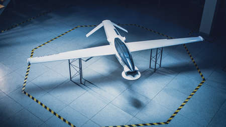 Elevated Shot of an Unmanned Aerial Vehicle Drone Prototype. Industrial Facility with Aircraft Capable of GPS Surveillance and Military Missions