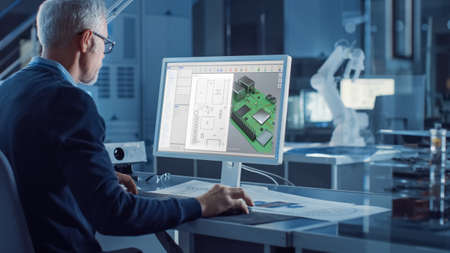 Engineer Works on Computer Uses CAD Software to Design 3D Industrial Machinery Component. In the Background Robot Arm Concept Standing in Heavy Industry Engineering Facility. Over the Shoulder Shot Stock fotó - 155444857
