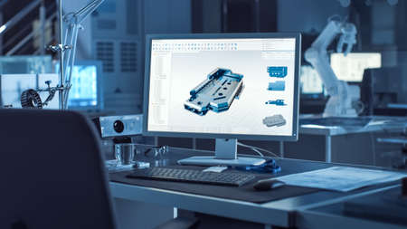 On the Desk Computer With CAD Software and Design of 3D Industrial Machinery Component. In the Background Robot Arm Concept Standing in Heavy the Dark.Industry Engineering Facility. Stock fotó