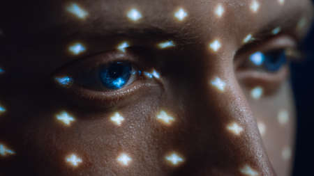 Biometric Facial Recognition Scanning of Blue Eyes Iris. Futuristic Concept: Projector Identifies Individual by Illuminating Face by Dots and Scanning with Laser. Close-up Shot